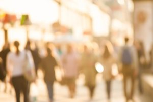 An out of focus picture of people walking on a downtown street. The point is our visual appearance should not matter in determining how to treat one another.